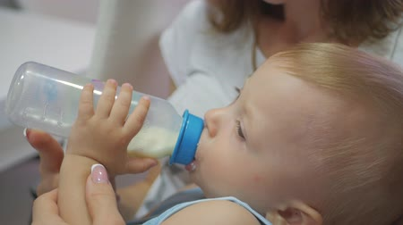 infant formula : Baby boy, asleep with bottle. Pretty baby boy drinking milk from bottle, close up. Stock Footage
