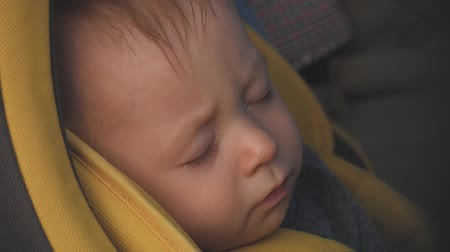 wozek dzieciecy : Sweet little baby boy sleeping in stroller.