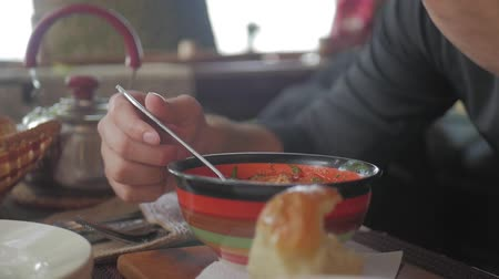 суп : Hands of unrecognisable man eating a soup at restaurant. A man eating a healthy meal, lunch. Fit lifestyle. Стоковые видеозаписи