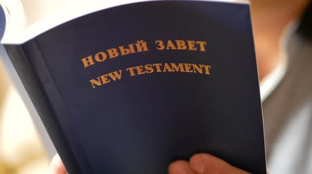bible study : Man is using a hand flip books to read. Close up of open book with pages flipping. Page of Bible, close-up.