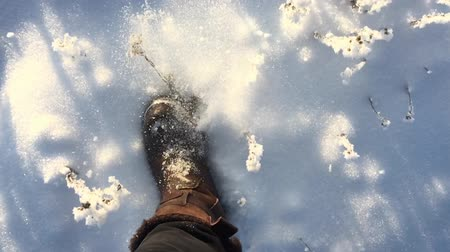 발자취 : Lonely man walking in the snow, close up man shoes. Walking concept. Slow motion. 무비클립