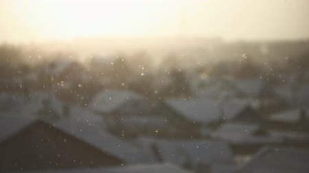 冬 : A snow scene of urban landscape covered in white snow in freezing weather, blurred background rooftops house