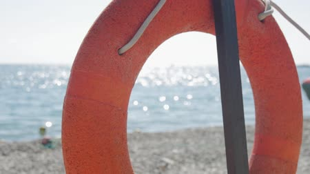 sós : Rescue buoy on the beach. Lifebuoy. Stock mozgókép