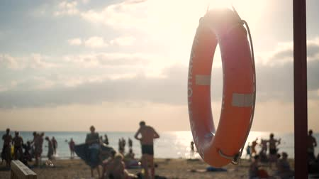 lifebuoy : Rescue buoy on the beach. Lifebuoy. Stock Footage