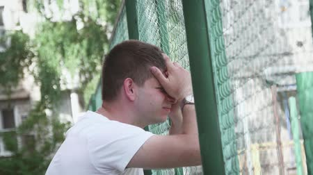 personalidade : Young man disorder and discontent, sadness, punches. Stock Footage
