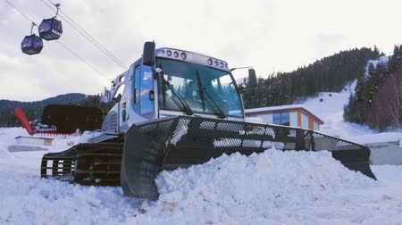buldozer : Ratrak in the hill mountains near ski resort cleaning snowdrift and preparation of slopes for skiing.