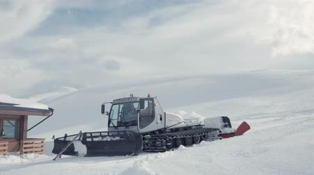 snowcat : Ratrak in the hill mountains near ski resort cleaning snowdrift and preparation of slopes for skiing.
