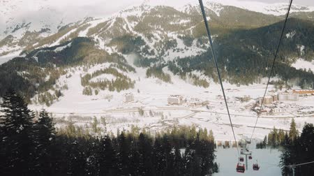 chair lift : Winter panorama with ski lifts and snow covered mountains on a sunny day. Mountains ski elevator in action.