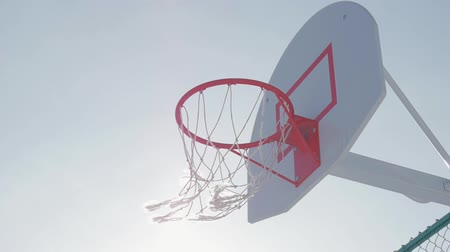 abroncs : Close up of basketball hoop at sun.