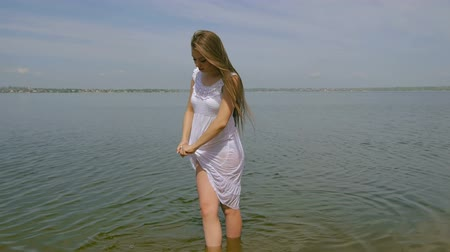 yay : Girl in a white out of the water (slow motion)