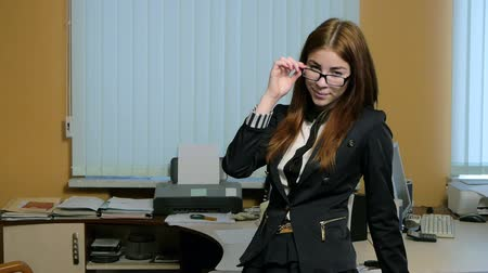 titkár : Young woman secretary at work at the office
