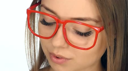 půvabný : The girl in the red glasses posing on a white background,slow motion