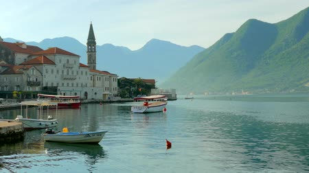 Черногория : Beach with boats in the town of Perast, in Montenegro Стоковые видеозаписи