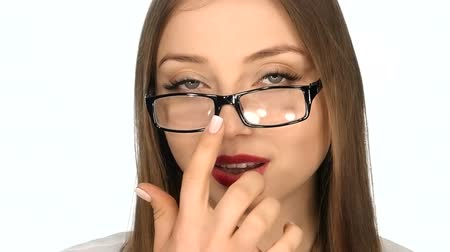 vidro : The girl in  glasses posing on a white background,slow motion