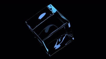 Glass cube rotates on black background