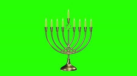 judaizm : Hanukkah background with menorah and burning candles. Green screen alpha Wideo