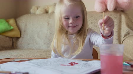 совершенство : Blonde child paints at home.