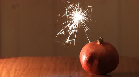 roma : red pomegranate with sparkler looking like christmas bomb