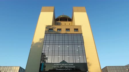 cimborák : NOVOSIBIRSK, RUSSIA - NOVEMBER 22, 2015: Vertical panorama of new building of Novosibirsk State University IN Novosibirsk Academgorodok on blue sky background at early morning