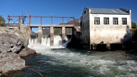 řev : View of falling water at hydroelectric power plant on Altai river Chemal