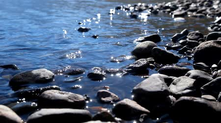 sivilceli : Stones on the shallow water of Lower Multinskoe lake in Altai, Siberia
