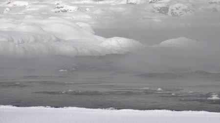 frazil ice : Floating of ice and sludge under vapor on Altai river Katun in winter season, Siberia, Russia