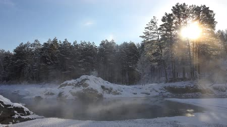 Panoramic Video of Blue Lakes on Katun river in Altai mountains in winter with Sun shining trough trees. Siberia, Russia