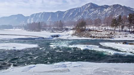 frazil ice : Rapids of Altai river Katun with banks covered by ice and snow in winter season near Elekmonar settlement, Siberia, Russia