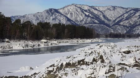 frazil ice : View on Katun river covered by ice and snow on Tekdelpen rapids from Oroktoi bridge in winter season. Altai, Siberia, Russia