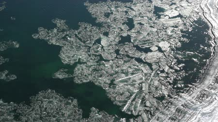 frazil ice : Aerial view on floating of ice and sludge on Altai river Katun in winter season between Usnezya and Elekmonar settlements, Siberia, Russia Stock Footage