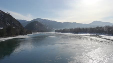 frazil ice : Aerial view on Altai river Katun between Usnezya and Elekmonar settlements with  floating of ice  in water and mountains on background in winter season , Siberia, Russia
