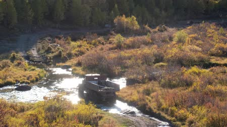 boggy : Very old russian truck crossing river Kurkurek on Altai mountain plateau Eshtykel. Siberia, Russia Stock Footage