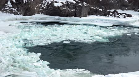 frazil ice : Floating of ice and sludge in whirlpool on Altai river Katun in winter season, Siberia, Russia