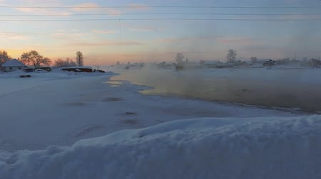 Motion video panorama of Altai village Semiletka and river Koksha in winter season. Siberia, Russia