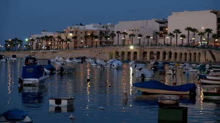 The night view of Marsaskala waterfront and Marsaskala Creek with the traditional Maltese fishing boats. Malta