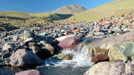 Rapids of small mountain river Ih Sair in natural boundary Tsagduult, western Mongolia. Gurgling water stream over stones and boulders.