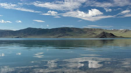 Calm waters of mongolian lake Tolbo-Nuur Stock mozgókép