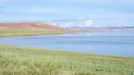 Panoramic video of the mongolian lake Telmen surrounded by hills and clouds