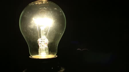 creativity : A light bulb illuminates a dark room, much like an idea in our mind with copy space