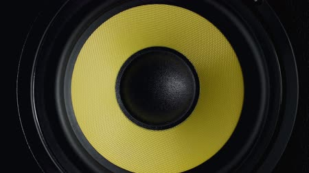 boxe : Close up at moving sub-woofer. Speaker part. Black and yellow colors. 4k video Stock Footage