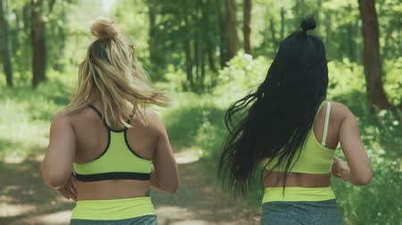 corredor : Backview of Fitness women jogging outdoors. Healthy lifestyle concept