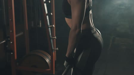 squat : Fitness woman doing barbell training in gym in slow motion