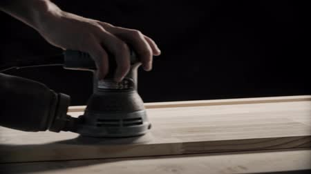 sander : Wood sanding machines. Carpenter working with electrical sander on table surface Stock Footage
