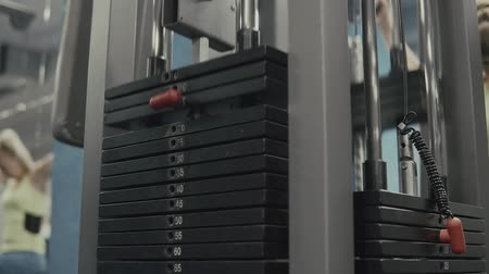 pound : Weight falling in block machine in gym Stock Footage