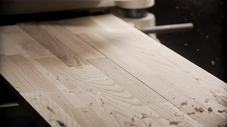 oak wood : Carpenter hand touches wooden board. Master hand blows away dust from boards