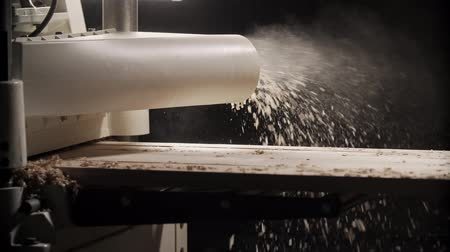 bandsaw : Wood machine processes board. Close up with flying sawdust