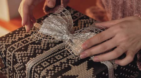 wrapped up : Girl wrapping present, christmas gift. Close up view of hands. Christmas concept