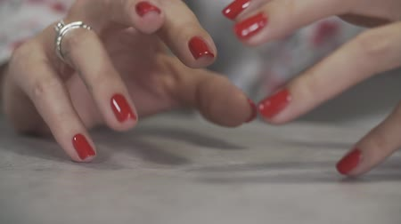 do it yourself : Female manicure of arm close up. Close up of womans fingers with red nails