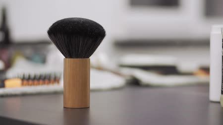 bigode : Brush for cleaning clients stands on table at barber shop with copy space