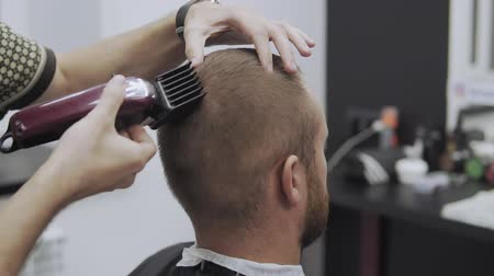Male haircut with electric razor. Close up of hair trimmer hairstyle Stock mozgókép